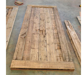 after fastening down the first layer of reclaimed timber to the plywood panels build a frame around the edge of the panel for effect