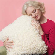 Knit a faux sheepskin cushion cover