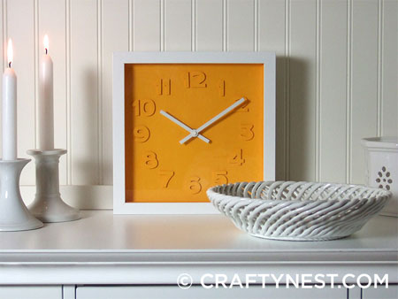 Colourful clock with embossed detail