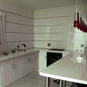 Kitchen walls and countertops tiled