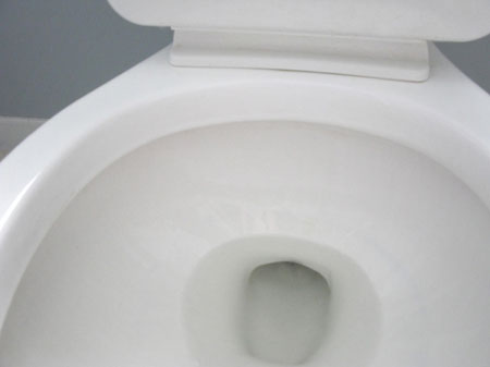 Remove dark stains from toilet
