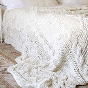 Knit a cable-pattern bed throw or blanket