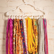 Coat hanger becomes a scarf rack