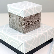 Cover up a plain box with wrapping paper