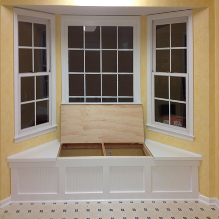 Any space directly under a window is normally wasted space and it makes  sense to use this to make a window seat where you - or the kids - can sit  back ...