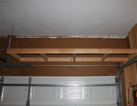 Home Dzine Home Diy Install Shelves Above Garage Door