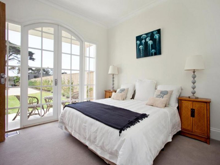 bedroom with double french doors