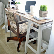 A desk with barstools and PAR pine