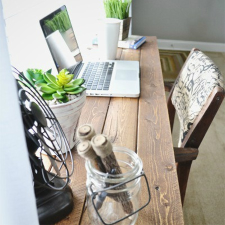Bar stools make a perfect desk for home office wooden desktop