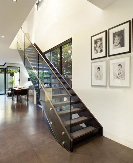 modern staircase with open glass panel side