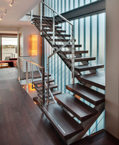 contemporary modern staircase with steel and wire sides