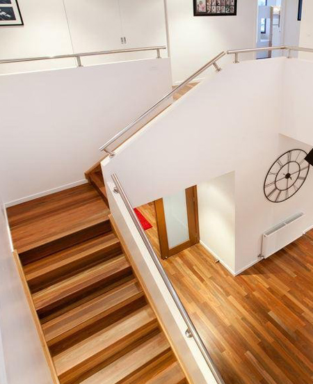 switchback staircase with timber wood stairs treads and steel bannister railings