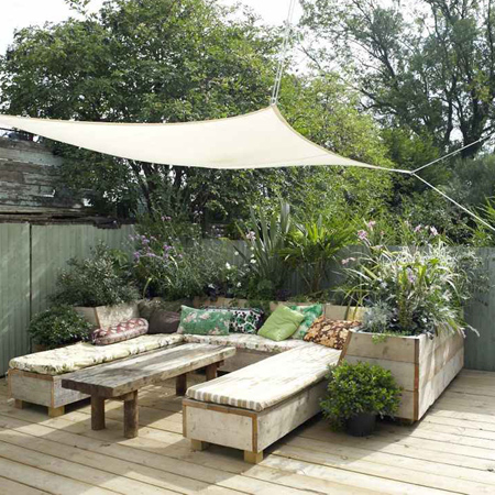 Eclectic style in vintage home reclaimed timber planters, benches and table