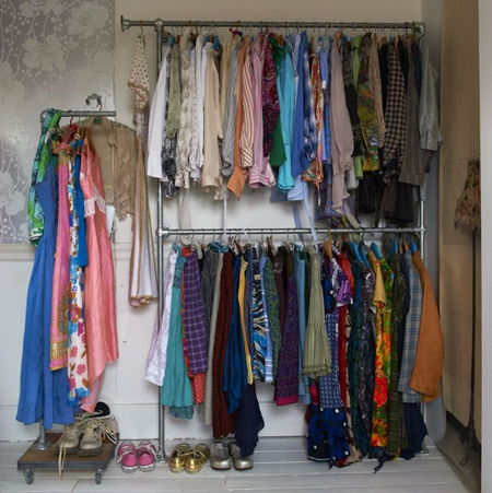 Eclectic style in vintage home gavanized pipe closet clothes hanger rack