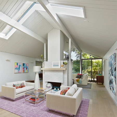 skylights and white painted panelling light bright home painted brick