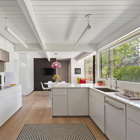 skylights and white painted panelling light bright home dark wood ceiling painted white