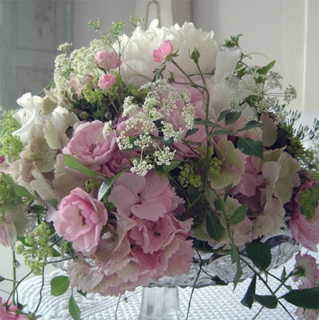 pink and white spring flower display arrangement