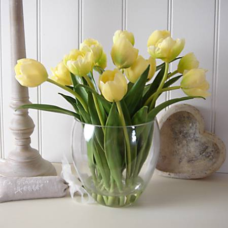 yellow tulips in glass vase