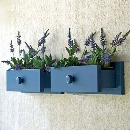Repurpose an old drawer into wall flower boxes planters