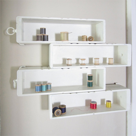 Repurpose an old drawer into storage shelves for craft or hobby room