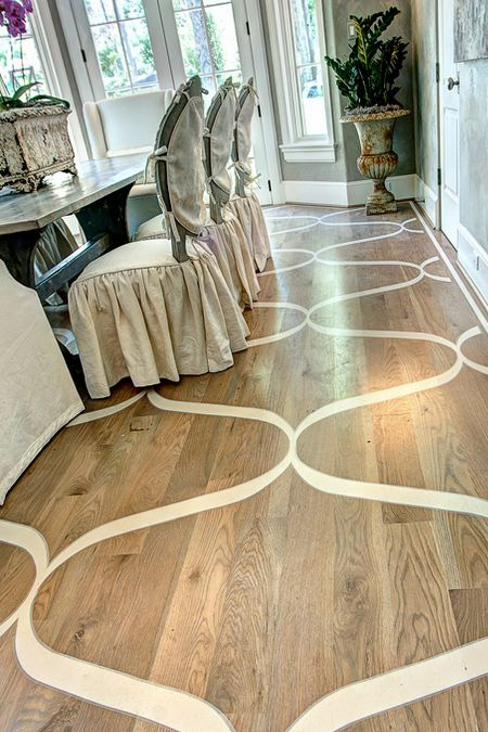 Painting A Design On Wooden Floor