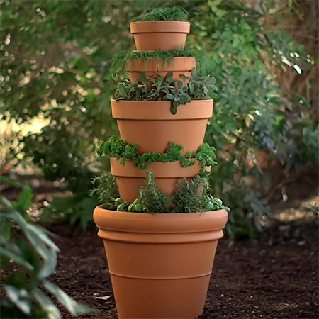Home dzine garden make a herb tower with plant pots for Balcony herb garden designs containers