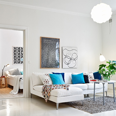 decorating with white living spaces interiors with blue accessories