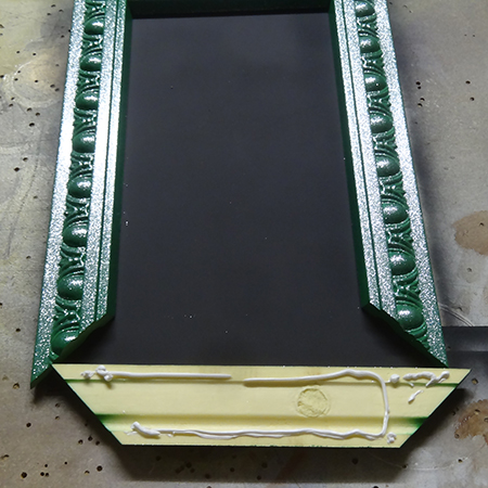 Use pattex no more nails adhesive to mount frame to chalkboard