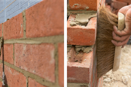 Basic bricklaying skills cleaning brickwork