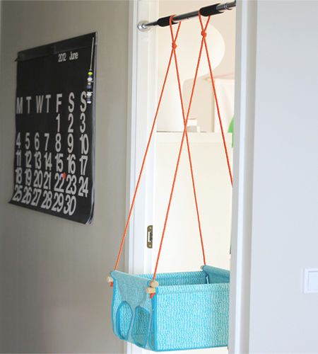 Door frame mounted child's swing