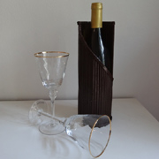 Rolled tube wine bottle holder