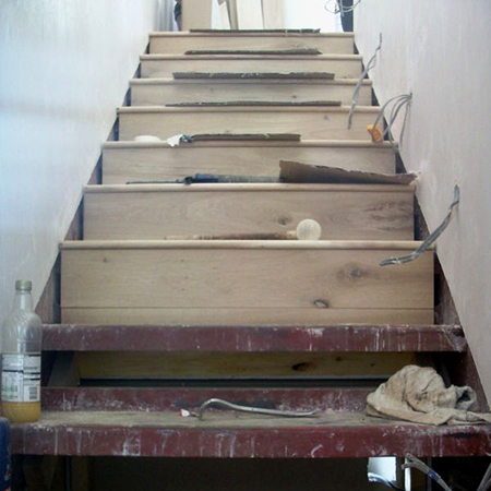 clad steel staircase with laminated wood flooring risers and steps