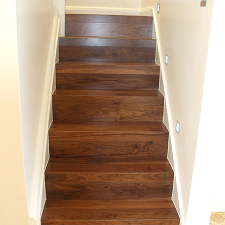 clad concrete staircase with laminated wood floor risers and steps - HOME DZINE Home Improvement Clad A Staircase With Wood