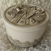 Biscuit tin turned into vintage sewing kit
