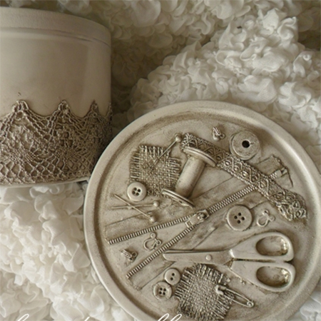 sewing kit made from old biscuit tin