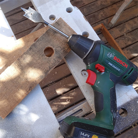drill holes in the uprights for the reclaimed timber wood bird feeder