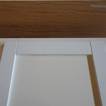glue strips frames around plain kitchen cabinet doors for shaker style