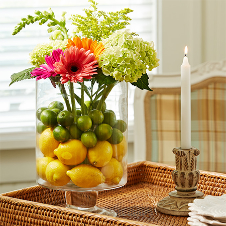 fill vase with lemon lime and fresh flowers for a colourful zesty table centrepiece