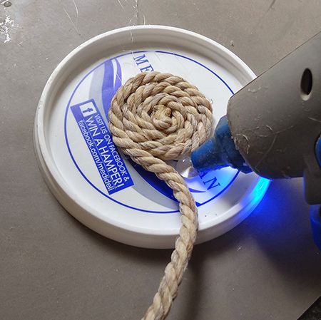 make coasters with plastic tub or container lids and a dremel hot glue gun