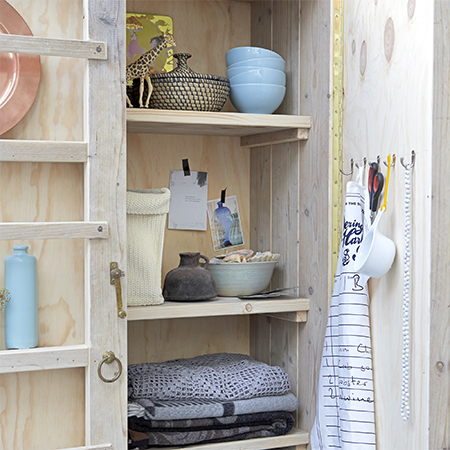 reclaimed wood is recycled into kitchen storage cabinet