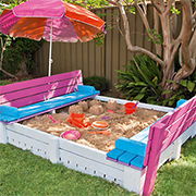 Sandpit with seating and lid
