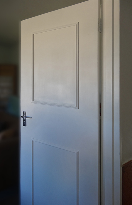 transform plain hollow-core doors into a feature using inexpensive pine moulding