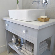 An old desk becomes a bathroom vanity
