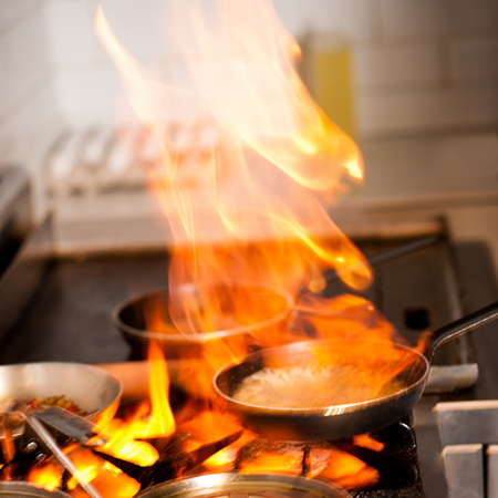 how to put out oil or grease fire in kitchen on stove or hob