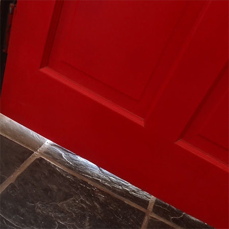 Large gaps under doors let in water and wind, yet it's so easy to cover up these areas with a door sweep