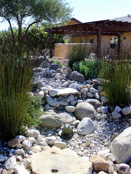 Pebble and rock river bed for garden drainage