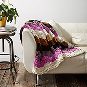 Colourful knitted throw or blanket