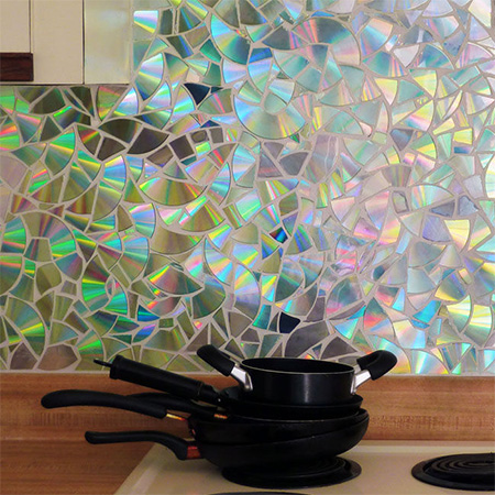 Recycle CD's into a gorgeous shimmering kitchen backsplash