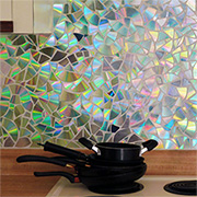 Recycle old CD's into a shimmering backsplash