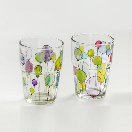 You can use glass stain to dress up inexpensive glassware